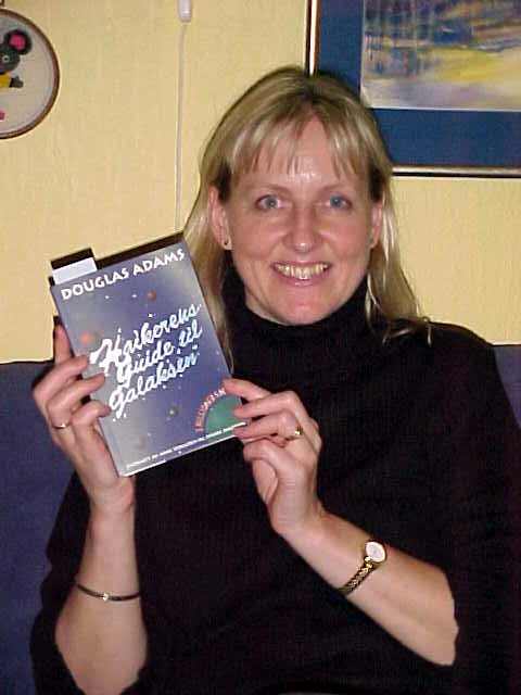 From John Alrid and Nikolai: Anna Margit Grindheim receives her letmestayforaday-gift. A Norwegian translation of Douglas Adams HitchHikers Guide To The Galaxy.