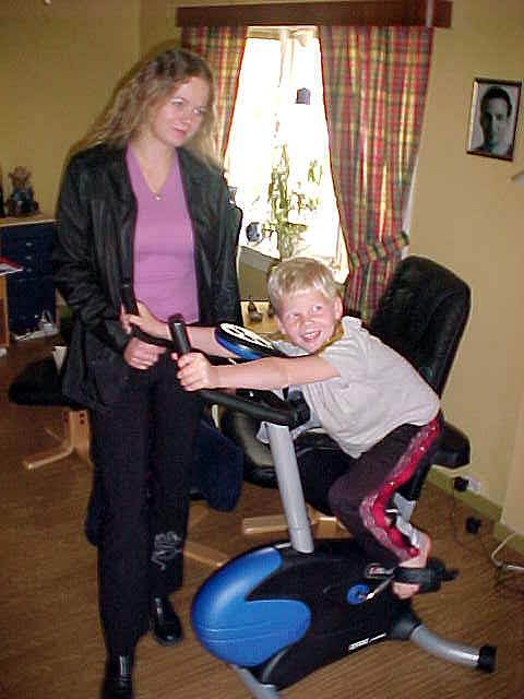 Ann Torild with her son Kenneth on the fitness bike.