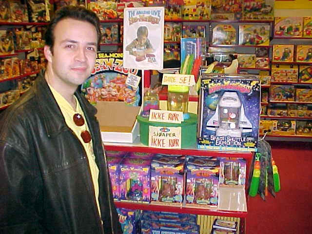 At the local toy store in a shopping mall, Ruben stands next to a collection of SeaMonkeys (TM). Together with Ann Torild their company Viastep is the only distribitor of SeaMonkeys in Scandinavia.