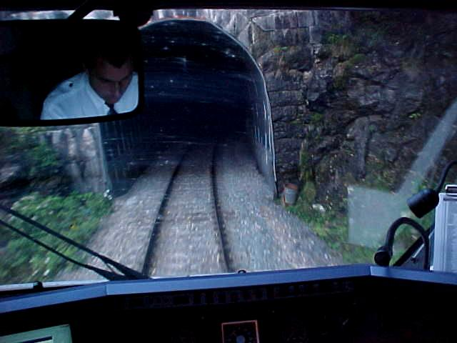 The traindriver invited me in his cabin. Here we just enter a tunnel. Only 2 miles long...