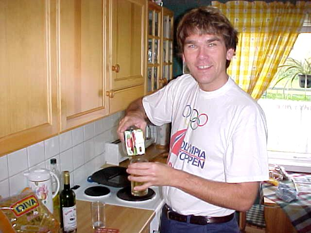 Frank Larssen in his kitchen, pooring a drink for me.
