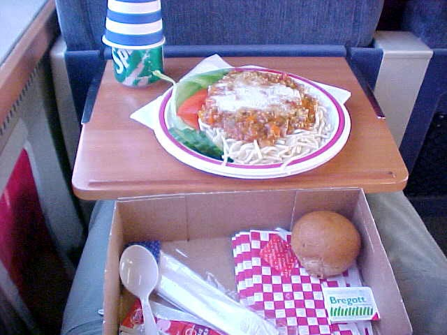 With a spaghetti bolognese meal in the train!