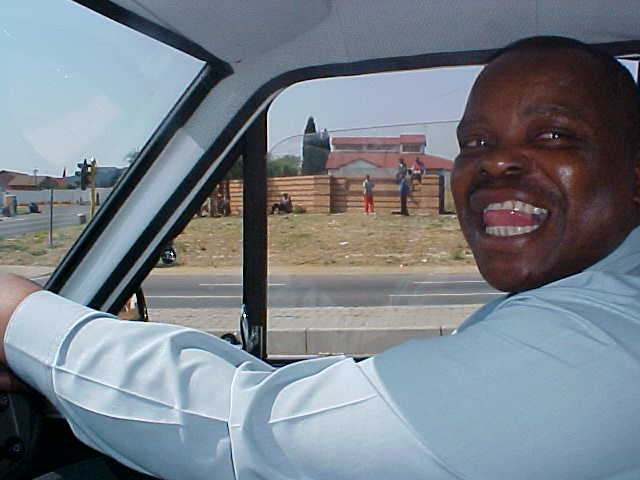 The messager of Etravel, Rodney, loved to have me in his car. On the background you see black people along the road. They wait for anybody who wants to pick them up for a job. Even for a day.