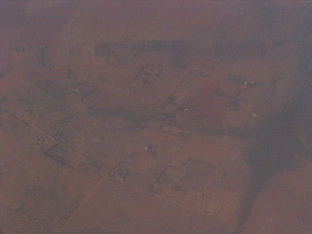 Not really clear, but a shot from 6,000 feet high, of small villages below.