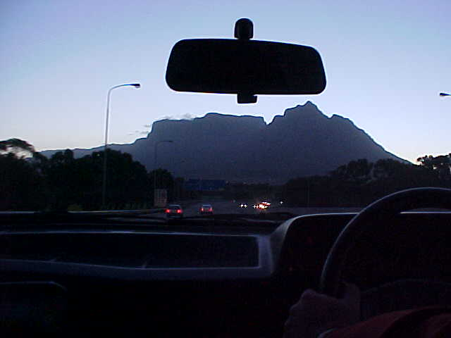 In the car with Ludo and Juanita towards Tamboerskloof, Cape Town. On the background the giant Table Mountain.