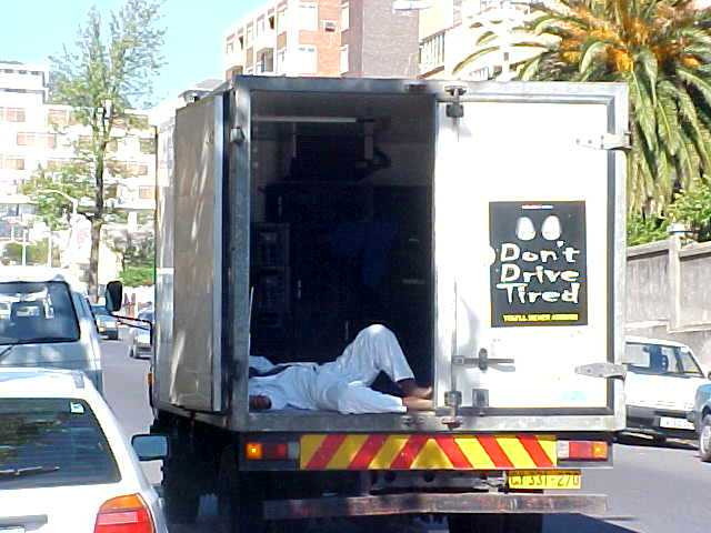 The trucks says: Dont Drive Tired. So what do you do if you are tired? Yes indeed, just sleep in your trunk...