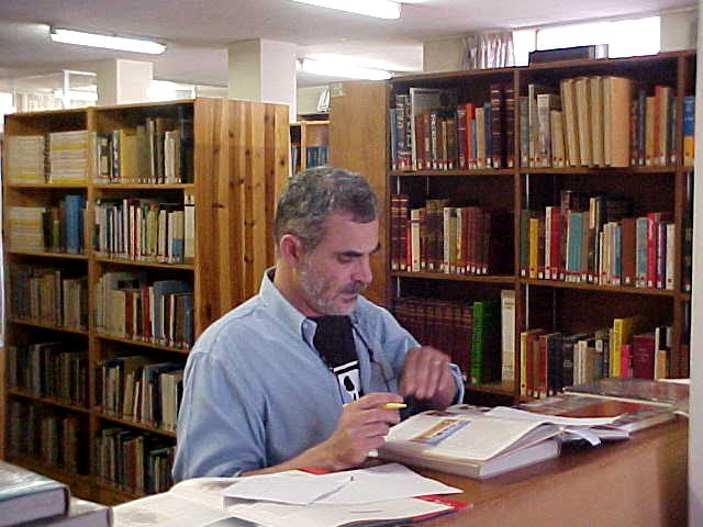 Jon Weinberg at the library, doing some research for his work as a museum designer.