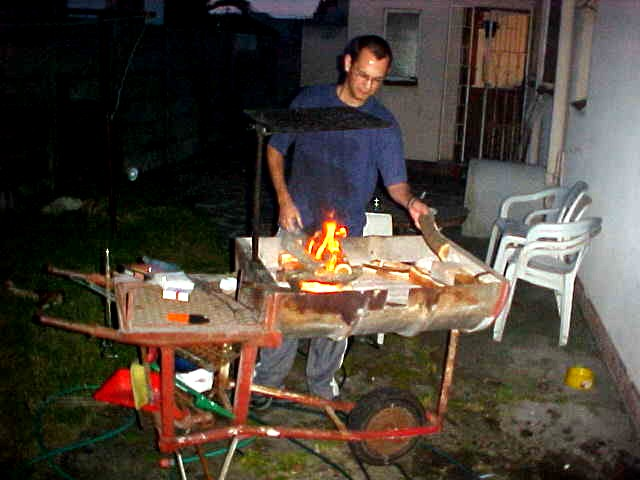 At night Kobus prepares the braai in the garden.