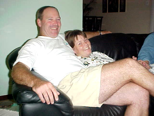 The after dinner settling on the couch: Rob and Cherise Griffin.