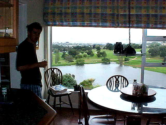 Malcom, the son of the Croucher family in Welgemoed, in their kitchen with a beautiful view on a golf course and other suburbs of Cape Town.