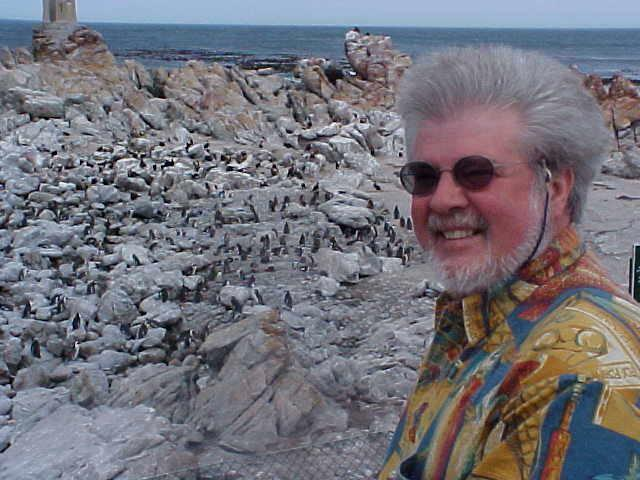 Grey-bearded and eversmiling Patrick in front of the penguins breeding places.