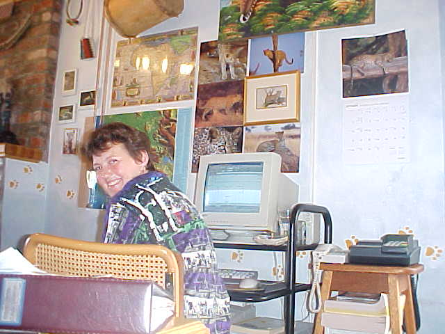 Nathalie behind her pc, doing her administration. Someone here is leopard crazy...