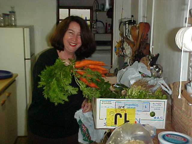 In her home, which she shares with her dad James, Wendy Nillsson unpacks her groceries in the kitchen.