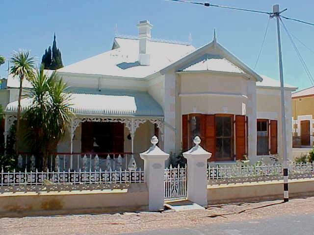 Just a lovely home in a Cape-Dutch style with a Victorian veranda. For sale for only 900,000 Rand...