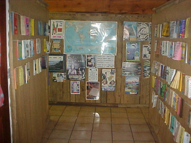 The entrance of the dorm at the Overlanders Backpackers lodge in Knysna is wallpapered with flyers of other backpackers. They make it hard for travellers to go home some day...