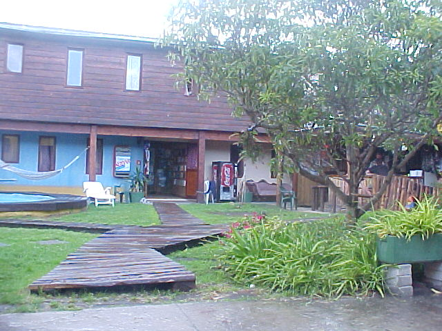 The dorm of the hostel is situated in the back garden. Wooden paths lead me to the entrance and the Banana Bar.