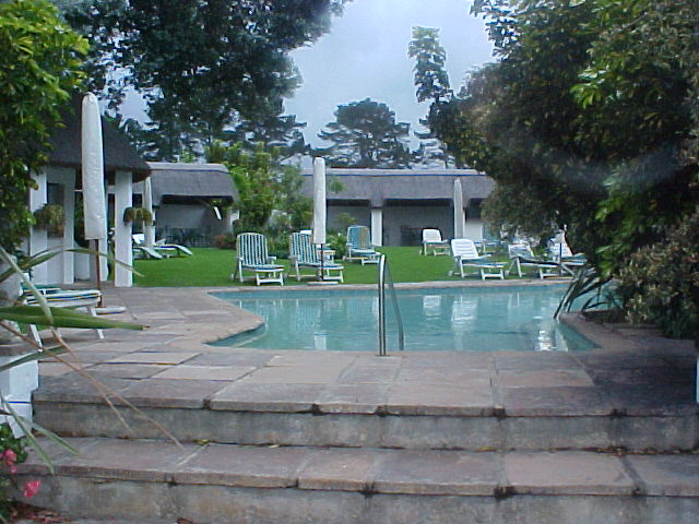 Overlooking the outdoor swimming pool with two bars at the Country House estate.