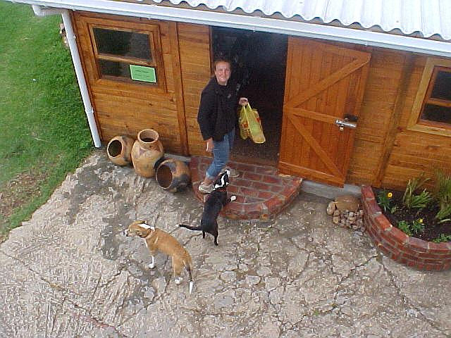 Mirjam with the dogs Toni and Dani at the front door.