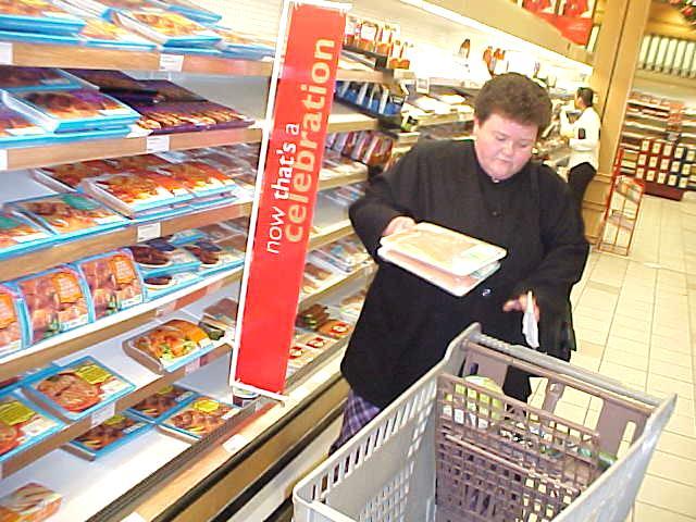 Hostess shops groceries for dinner.
