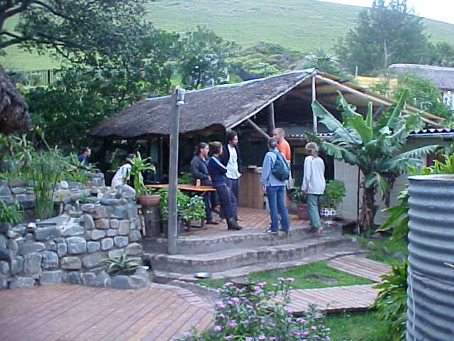 The back garden of the Coffee Shack, with one of the open huts and a lot of green.