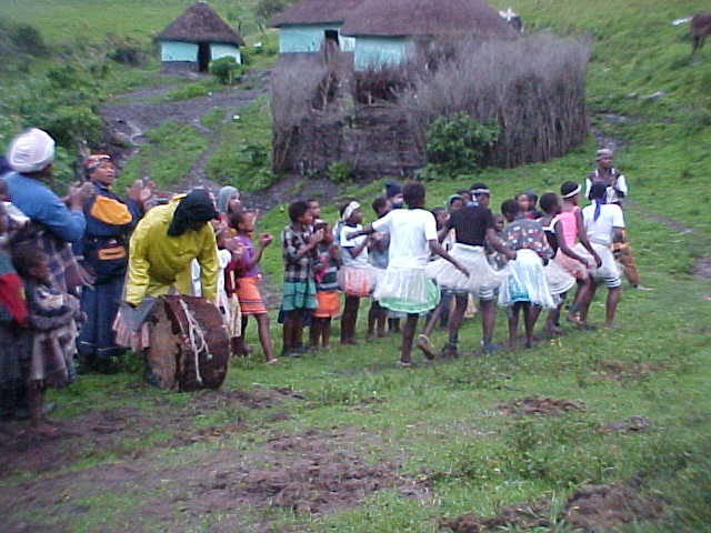 Standing in a line with a big mama banging the drum, the kids performed their acts to all of us.
