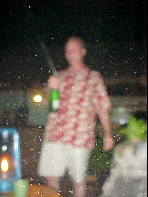 Of course the crazy Dutchman had to shake the bottle of Southafrican Champaign before opening. Well, Jeff is a good photographer, but even he could not avoid the champaign drops hitting the lense..
