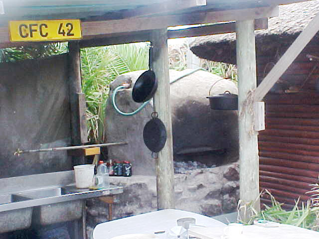 A view on the public kitchen. A small fire warms up the watertank in the back, ready for warm (clean) river water.
