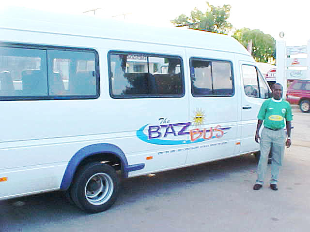 Petrus was the driver of the bus and he proudly posed in front of His Car.