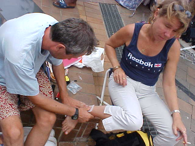 Muti places some traceable paper on Ulrikas ankle...