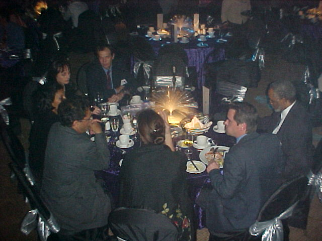 Journalists dressed as penguins, on one of the twenty-five tables in this castle hall.