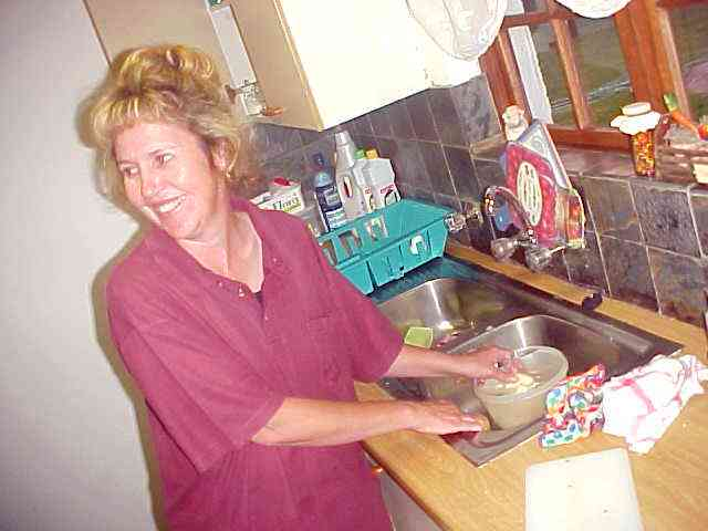 In the kitchen mother Moll heats up todays fast food and prepares a Greek salad for dinner.