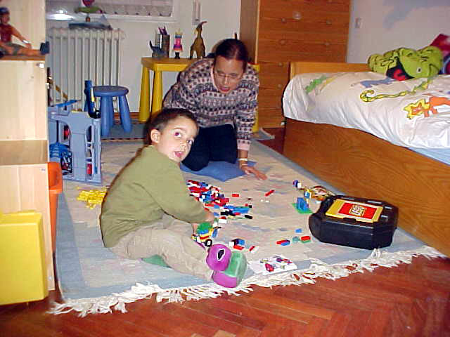 Miguel, Belens 4yo son, playing with his lego and nanny in his bedroom.