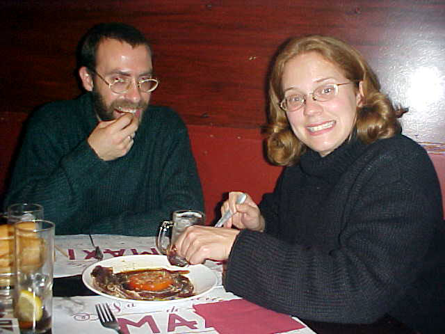 Juan Lara and Anna Mayer attacking food.