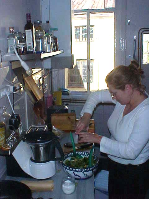 Anna prepares a fresh salad for lunch.
