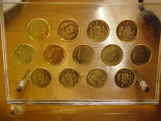 a collection box with the original gold plated ten peseata coins...
