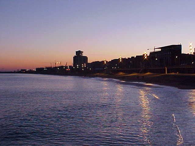 Barceloneta, an old harbour village along the water, as seen from the pier.