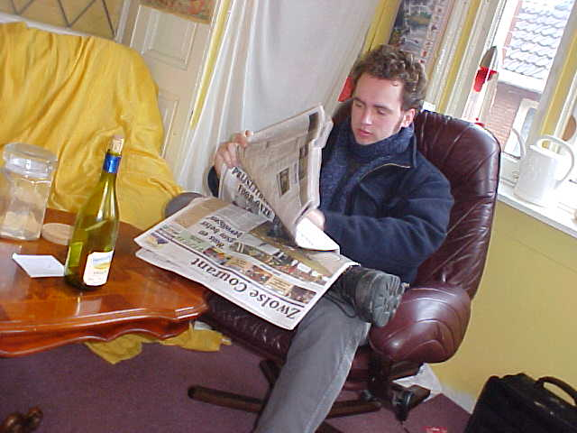 Munk reading the newspaper in my student room.