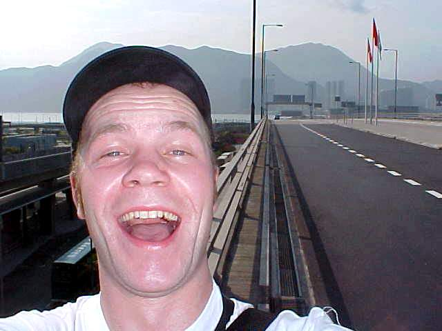 Me, outside the Hong Kong Airport. Little eyes, because of less sleep and the humidity.
