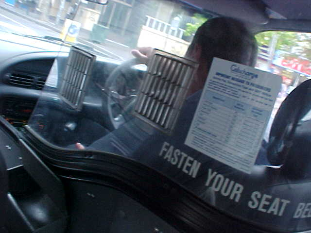 The taxis in Sydney are horrifying! The drivers hardly talk and are settled in this plastic protection cocoon.