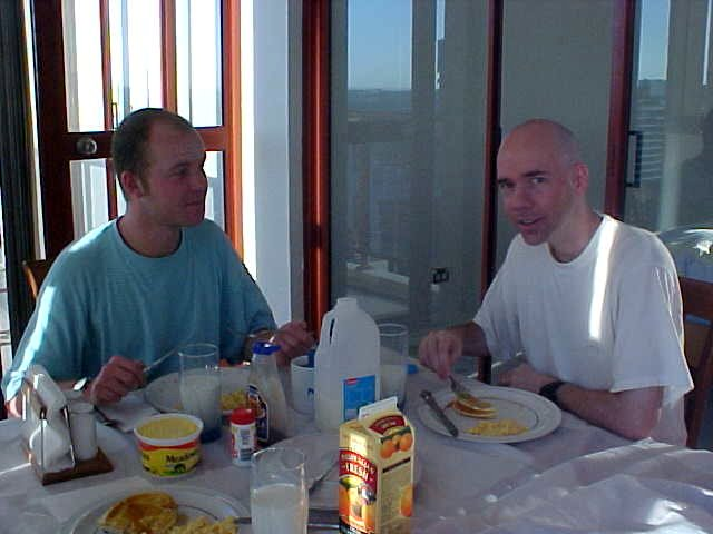 Russell and me, during breakfast on the covered balcony. We had to close the curtains because of the hot sunrays.