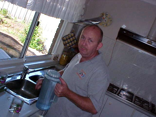 Ron fills up the necessary cold water (that is a bird on his head)...