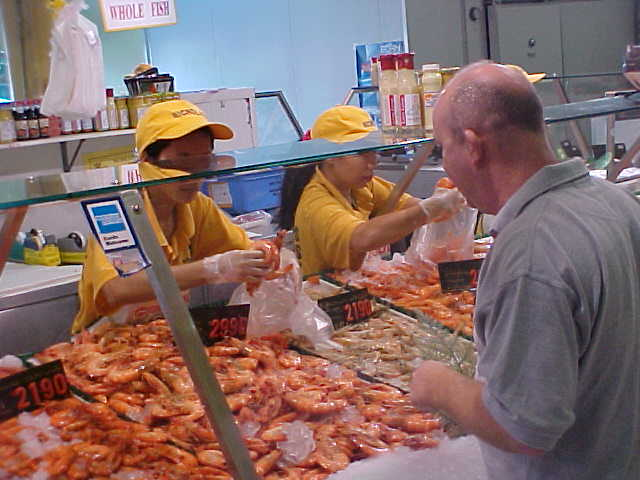 My next host Ron does some shopping for fish at the Sydney fishmarket.