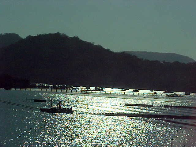 A small fishing harbour, taken with the sun up high (that explains the dark contrast)