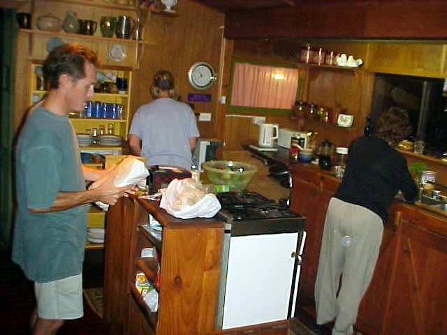 Mark, Rhonda and Del in the kitchen, busy for dinner.