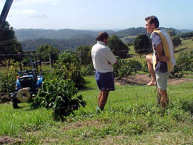 Mark talks with a local coffee bean farmer...