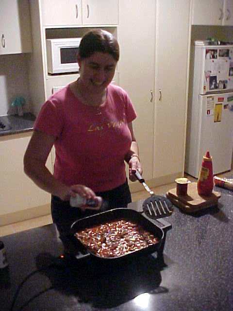 Kylie prepares spaghetti bolognese in the kitchen...