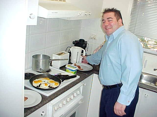 Sam Forbes prepares morning breakfast for the both of us in the kitchen.