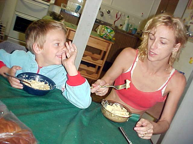 Back home at the dinner table. We ate package pasta with bread and little Stephen suggests we could put it in our noses too!