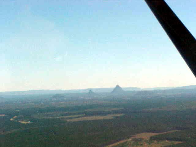 The Glasshouse Mountains as seen from a distance. Captain Cook named this mountains like that as they look like they are behind a glass wall when it rains. As you can see, they also look like that when it is not raining...