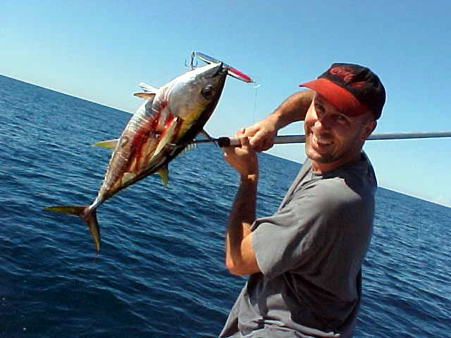 Glen shows his first catch for the day: a yelow fin tunafish!
